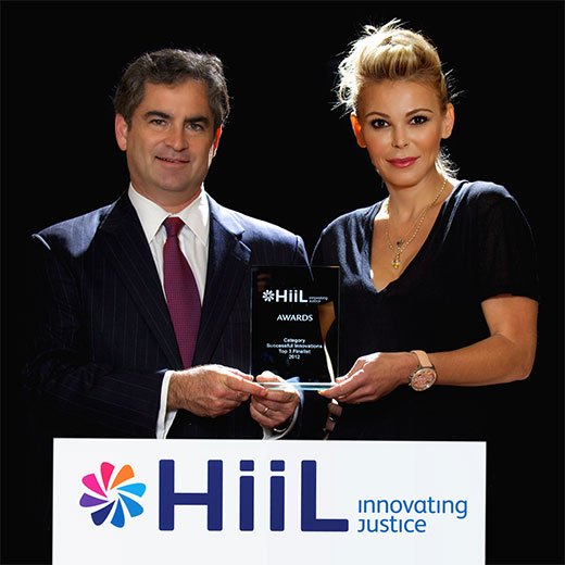 Professor Richard Steinberg and Diana Jenkins with the HiiL Innovating Justice award.